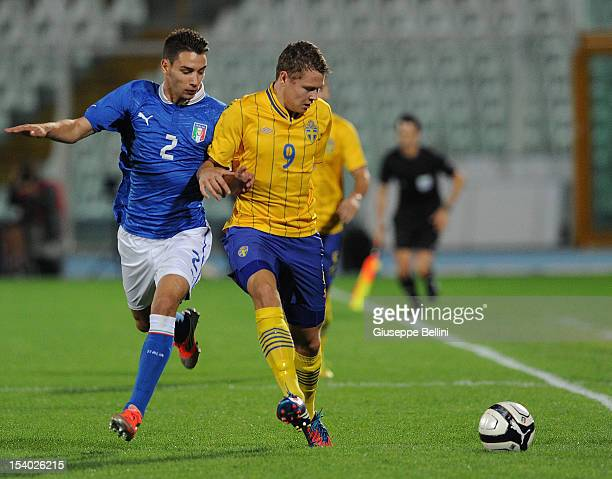 Mattia De Sciglio of Italy and ViiktorClaesson of Sweden in action during the UEFA European Under21 Championship playoff match between Italy and...