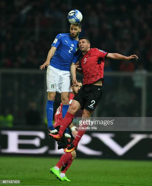 Mattia De Sciglio of Italy competes for the ball with Andi Lila of Albanial during the FIFA 2018 World Cup Qualifier between Italy and Albania at...
