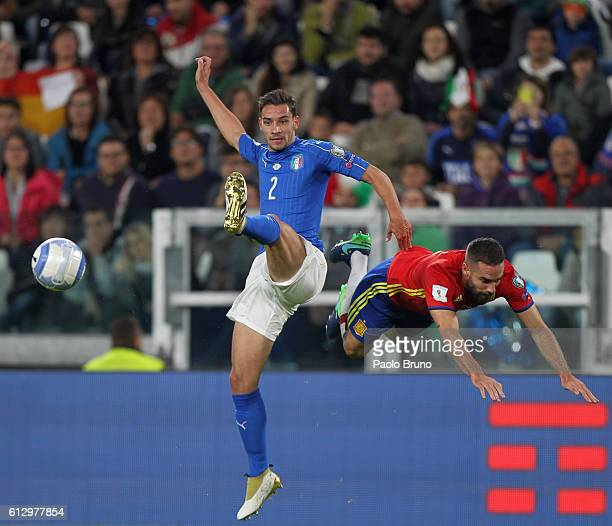 Mattia De Sciglio of Italy competes for the ball with Dani Carvajal of Spain during the FIFA 2018 World Cup Qualifier between Italy and Spain at...