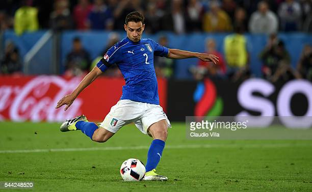 Mattia De Sciglio of Italy scores at the penalty shootout during the UEFA EURO 2016 quarter final match between Germany and Italy at Stade Matmut...