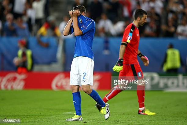 Mattia De Sciglio of Italy shows his dejeciton after Germany's first goal during the UEFA EURO 2016 quarter final match between Germany and Italy at...