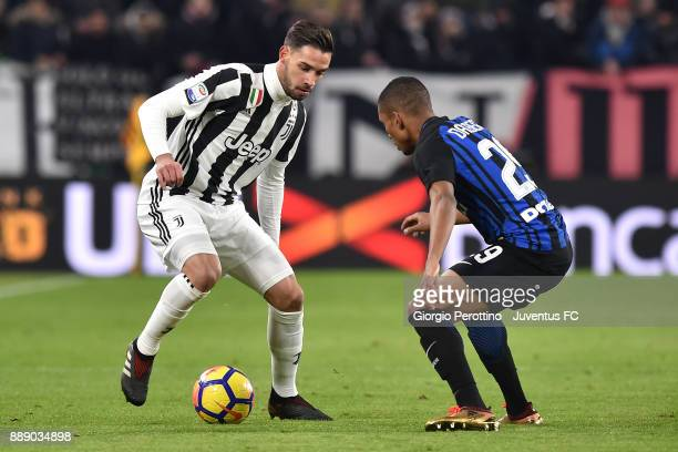 Mattia De Sciglio of Juventus and Dalbert Henrique of FC Internazionale compete for the ball during the Serie A match between Juventus and FC...