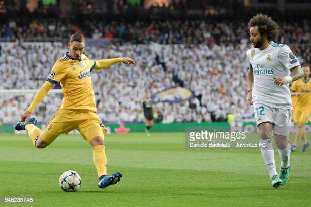 Mattia De Sciglio of Juventus and Marcelo of Real Madrid in action during the Champions League match between Real Madrid and Juventus at Estadio...