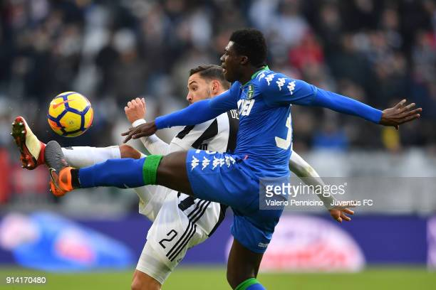 Mattia De Sciglio of Juventus competes for the ball with Alfred Duncan of Sassuolo during the serie A match between Juventus and US Sassuolo on...