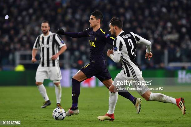 Mattia De Sciglio of Juventus competes for the ball with Erik Lamela of Tottenham Hotspur FC during the UEFA Champions League Round of 16 First Leg...