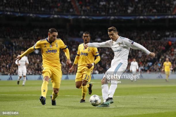 Mattia De Sciglio of Juventus FC Douglas Costa of Juventus FC Cristiano Ronaldo of Real Madrid during the UEFA Champions League quarter final match...