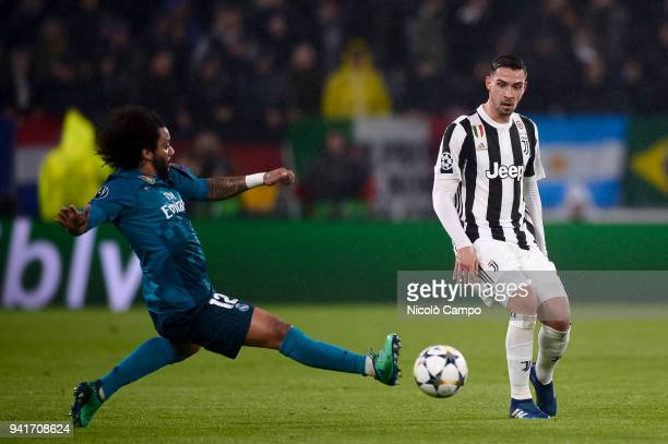Mattia De Sciglio of Juventus FC is tackled by Marcelo of Real Madrid CF during the UEFA Champions Quarter Final Leg One match between Juventus FC...
