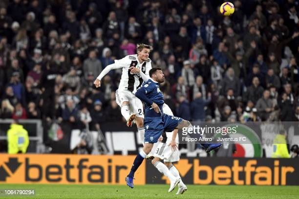 Mattia De Sciglio of Juventus goes up with Andrea Petagna of SPAL during the Serie A match between Juventus and SPAL at Allianz Stadium on November...