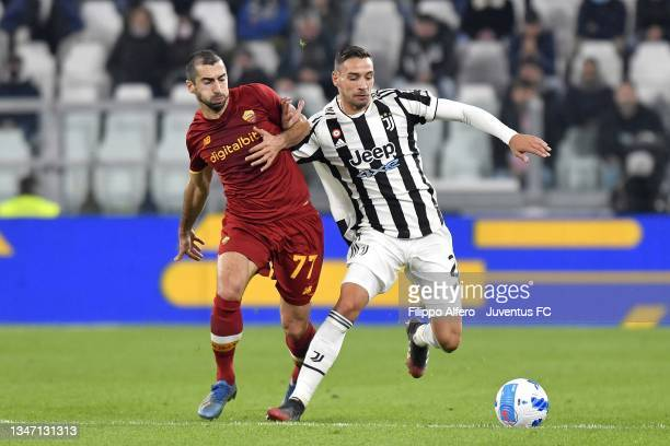 Mattia De Sciglio of Juventus is challenged by Henrikh Mkhitaryan of AS Roma during the Serie A match between Juventus and AS Roma at Allianz Stadium...