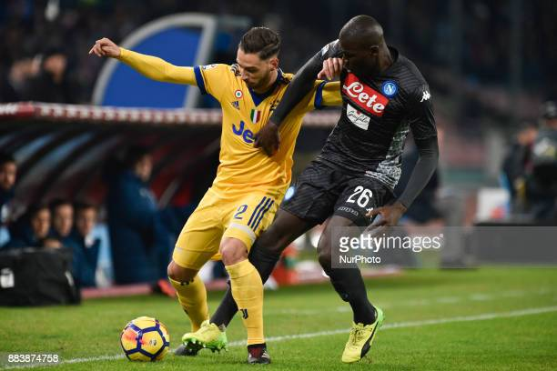 Mattia De Sciglio of Juventus is challenged by Kalidou Koulibaly of Napoli during the Serie A match between Napoli and Juventus at San Paolo Stadium...