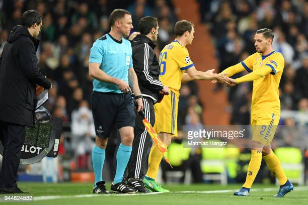 Mattia De Sciglio of Juventus is substituted off as Stephan Lichtsteiner of Juventus comes on during the UEFA Champions League Quarter Final Second...