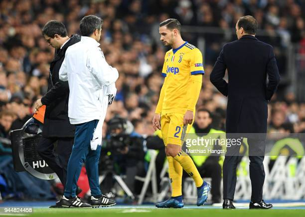 Mattia De Sciglio of Juventus is substituted off during the UEFA Champions League Quarter Final Second Leg match between Real Madrid and Juventus at...