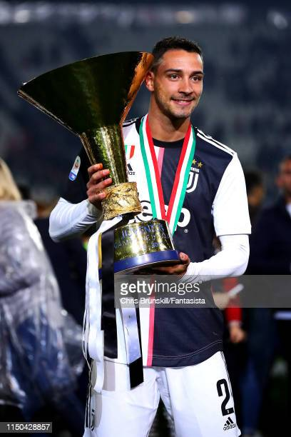 Mattia De Sciglio of Juventus poses with the Serie A trophy following the Serie A match between Juventus and Atalanta BC at Allianz Stadium on May 19...