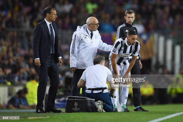 Mattia De Sciglio of Juventus receives treatment from the medical team during the UEFA Champions League Group D match between FC Barcelona and...
