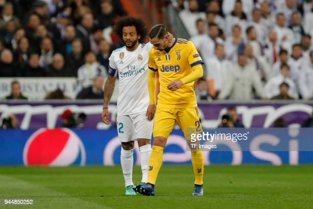 Mattia De Sciglio of Juventus Turin leaves the field injured and Marcelo of Real Madrid gestures during the UEFA Champions League quarter final...