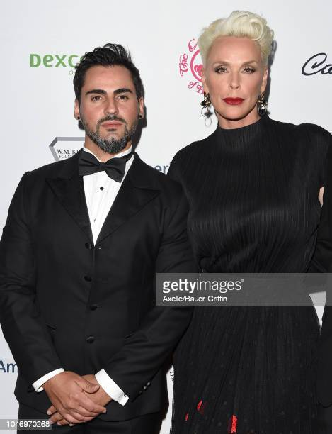 Mattia Dessi and Brigitte Nielsen attend the 2018 Carousel of Hope Ball at The Beverly Hilton Hotel on October 6 2018 in Beverly Hills California