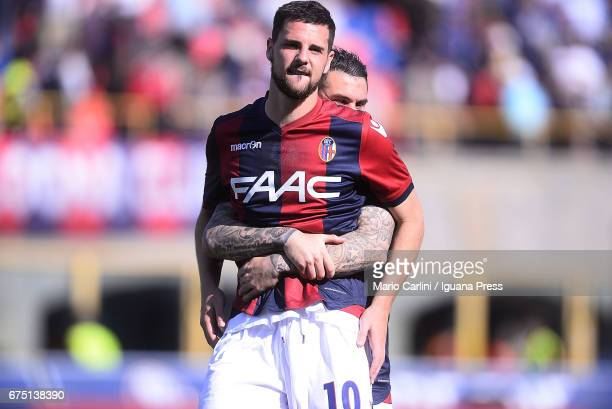 Mattia Destro celebrates with his teamate Federico Viviani at the end of the Serie A match between Bologna FC and Udinese Calcio at Stadio Renato...