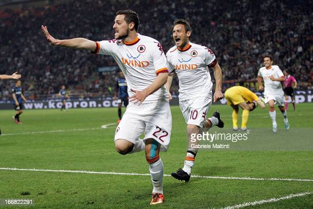 Mattia Destro of AS Roma celebrates after scoring a goal during the TIM Cup semifinal match between FC Internazionale Milano and AS Roma at Giuseppe...