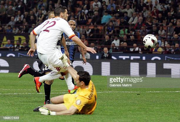 Mattia Destro of AS Roma scores a goal during the TIM Cup semifinal match between FC Internazionale Milano and AS Roma at Giuseppe Meazza Stadium on...