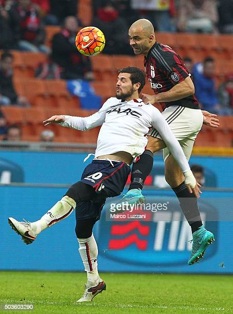 Mattia Destro of Bologna FC competes for the ball with Alex Dias da Costa of AC Milan during the Serie A match between AC Milan and Bologna FC at...