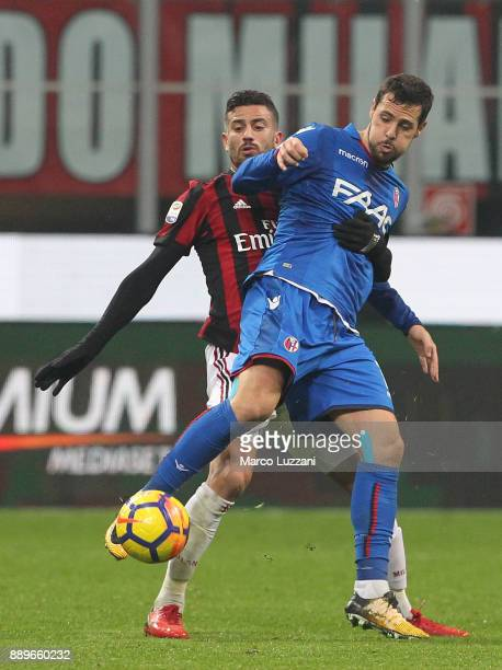 Mattia Destro of Bologna FC competes for the ball with Mateo Musacchio of AC Milan during the Serie A match between AC Milan and Bologna FC at Stadio...
