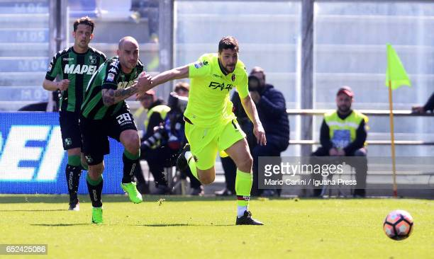 Mattia Destro of Bologna FC competes the ball with Paolo Cannavaro of US Sassuolo during the Serie A match between US Sassuolo and Bologna FC at...
