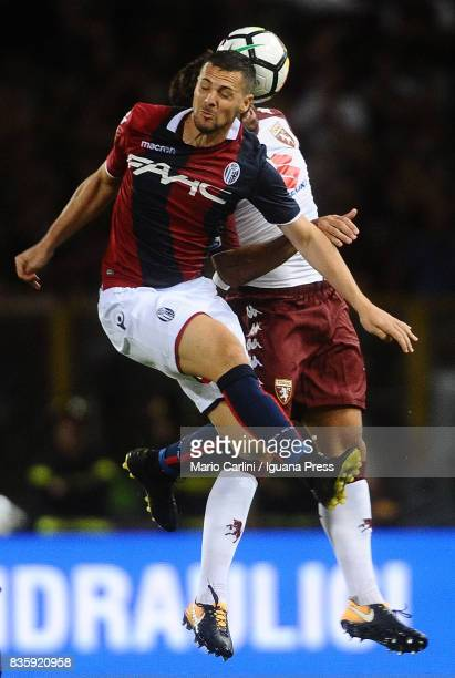 Mattia Destro of Bologna FC heads the ball during the Serie A match between Bologna FC and Torino FC at Stadio Renato Dall'Ara on August 20 2017 in...