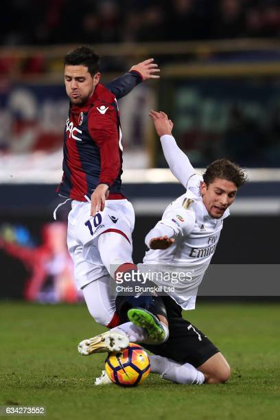 Mattia Destro of Bologna FC in action with Manuel Locatelli of AC Milan during the Serie A match between Bologna FC and AC Milan at Stadio Renato...