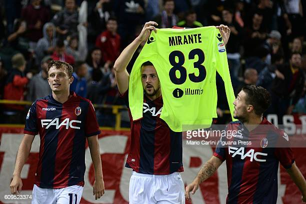 Mattia Destro of Bologna FC shows the jersey of his teamate Antonio Mirante as celebrates after scoring his team's second goal during the Serie A...