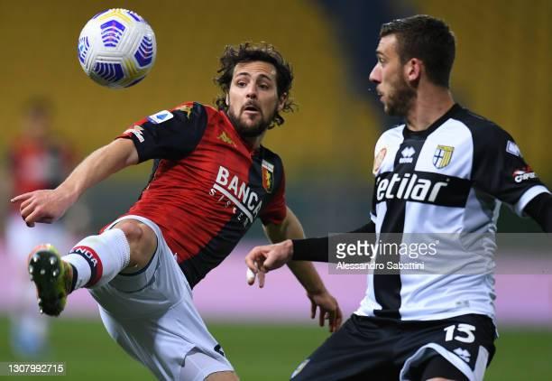 Mattia Destro of Genoa CFC and Mattia Bani of Parma Calcio in action during the Serie A match between Parma Calcio and Genoa CFC at Stadio Ennio...