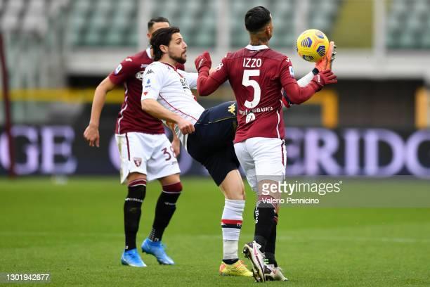Mattia Destro of Genoa C.F.C. Controls the ball under pressure from Armando Izzo of Torino FC during the Serie A match between Torino FC and Genoa...