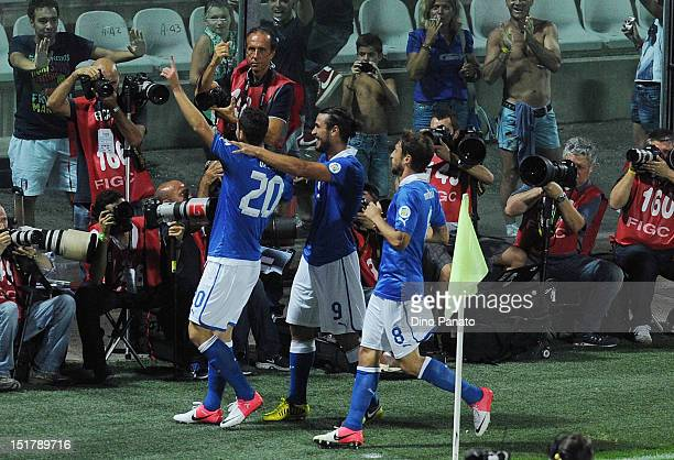 Mattia Destro of Italy celebrates with is team mates after scoring his opening goal during the FIFA 2014 World Cup qualifier match between Italy and...