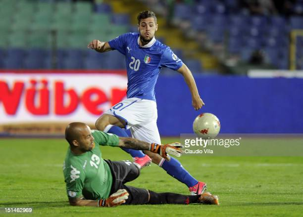 Mattia Destro of Itay and goalkeeper Nikolay Mihaylov of Bulgaria in action during the FIFA 2014 World Cup Qualifier group B match between Bulgaria...