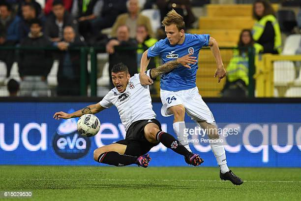 Mattia Mustacchio of FC Pro Vercelli is tackled by Lorenzo Dickmann of Novara Calcio during the Serie B match between FC Pro Vercelli and Novara...