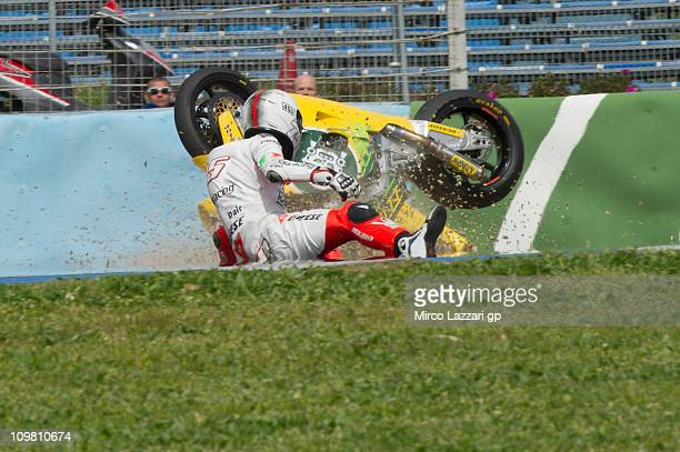 Mattia Pasini of Italy and Ioda Racing Project crashes during the third day of Moto2 And 125cc IRTA testing at Circuito de Jerez on March 6, 2011 in...