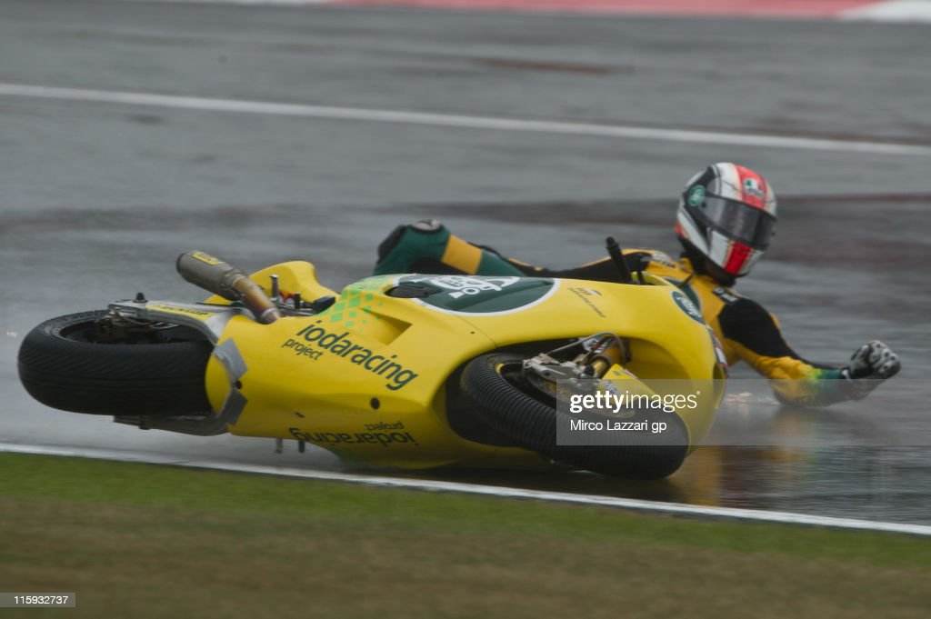 Mattia Pasini of Italy and Ioda Racing Project crashes out during the Moto2 race of MotoGp Of Great Britain at Silverstone Circuit on June 12, 2011 in Northampton, England.