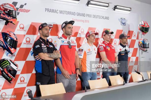 Mattia Pasini of Italy and Italtrans Racing Danilo Petrucci of Italy and Alma Pramac Racing Marc Marquez of Spain and Repsol Honda Team Jorge Lorenzo...