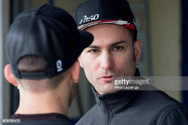 Mattia Pasini of Italy and Italtrans Racing speaks in pit during the Moto2 Moto3 Tests In Jerez at Circuito de Jerez on March 8 2018 in Jerez de la...