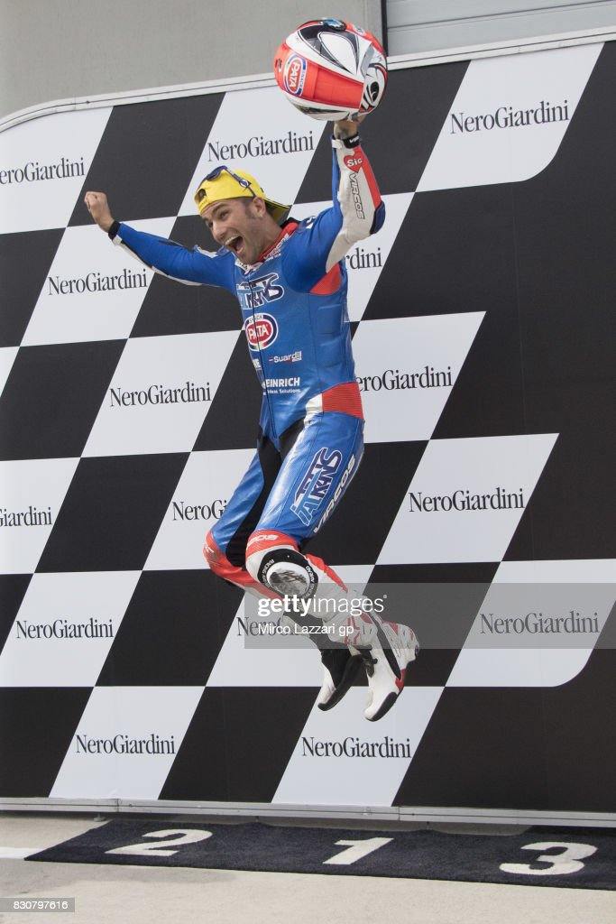 Mattia Pasini of Italy and Italtrans Racing Team celebrates the pole podition at the end of the qualifying practice during the MotoGp of Austria - Qualifying at Red Bull Ring on August 12, 2017 in Spielberg, Austria.