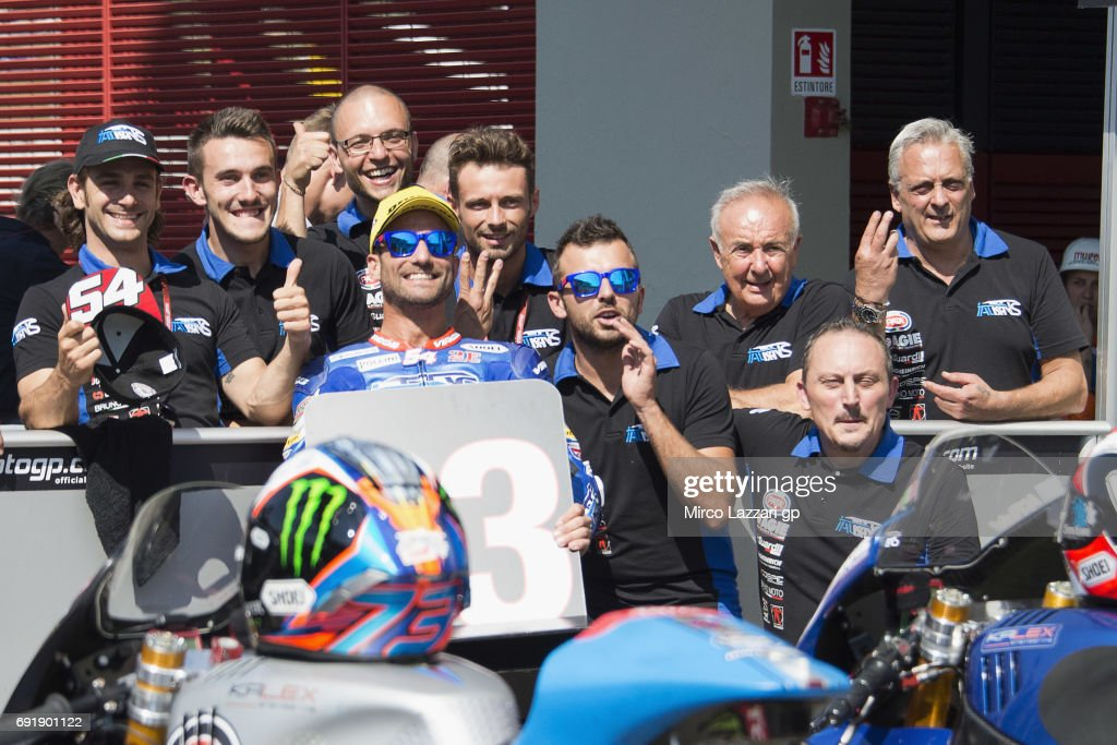 Mattia Pasini of Italy and Italtrans Racing Team celebrates with team at the end of the qualifying practice during the MotoGp of Italy - Qualifying at Mugello Circuit on June 3, 2017 in Scarperia, Italy.