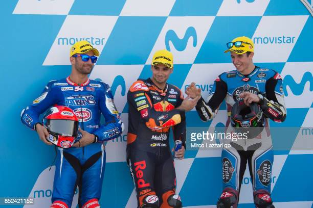 Mattia Pasini of Italy and Italtrans Racing Team Miguel Oliveira of Portugal and Red Bull KTM Ajo and Alex Marquez of Spain and EG 00 Marc VDS...