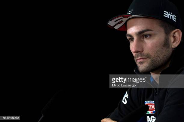 Mattia Pasini of Italy and Italtrans Racing Team smiles during the press conference at the end of the Moto2 qualifying practice during qualifying for...