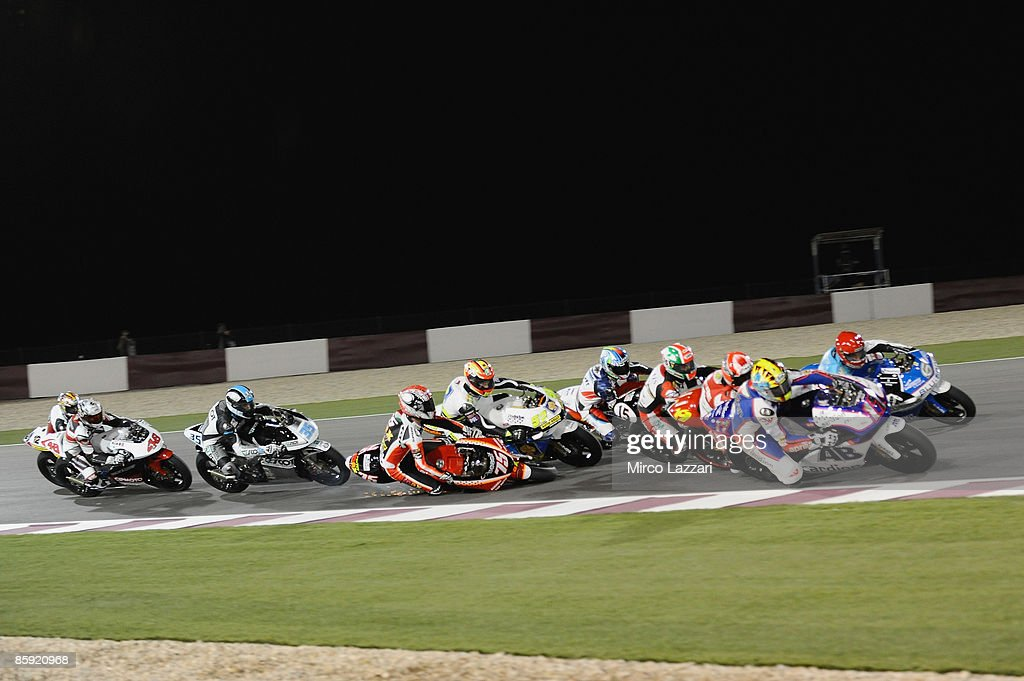 Mattia Pasini of Italy and Team Toth Aprilia crash during the race to the Motorcycle Grand Prix of Doha on April 12, 2009 in Doha, Qatar.