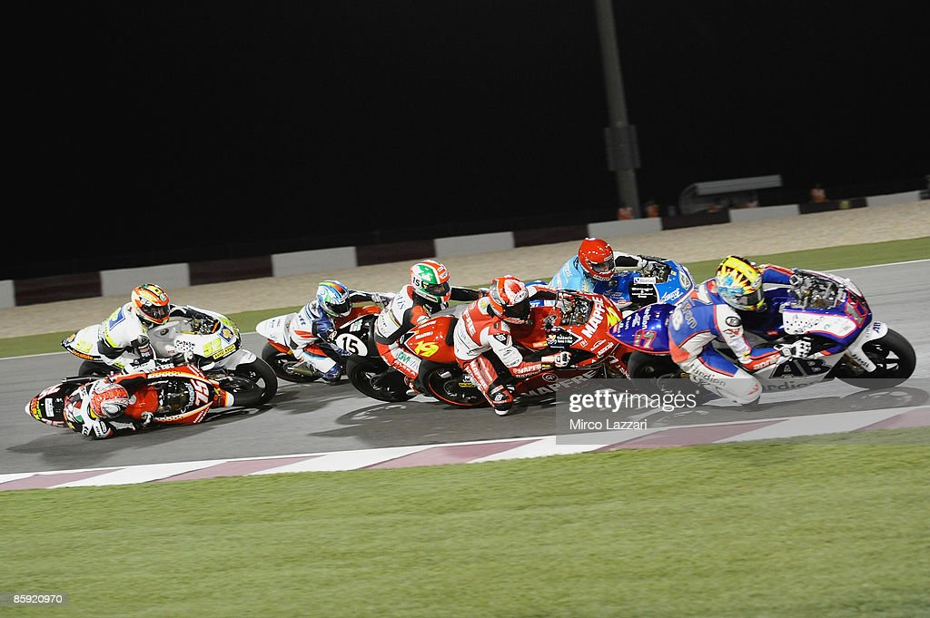 Mattia Pasini of Italy and Team Toth Aprilia crash during the race to the Motorcycle Grand Prix of Doha on April 11, 2009 in Doha, Qatar.