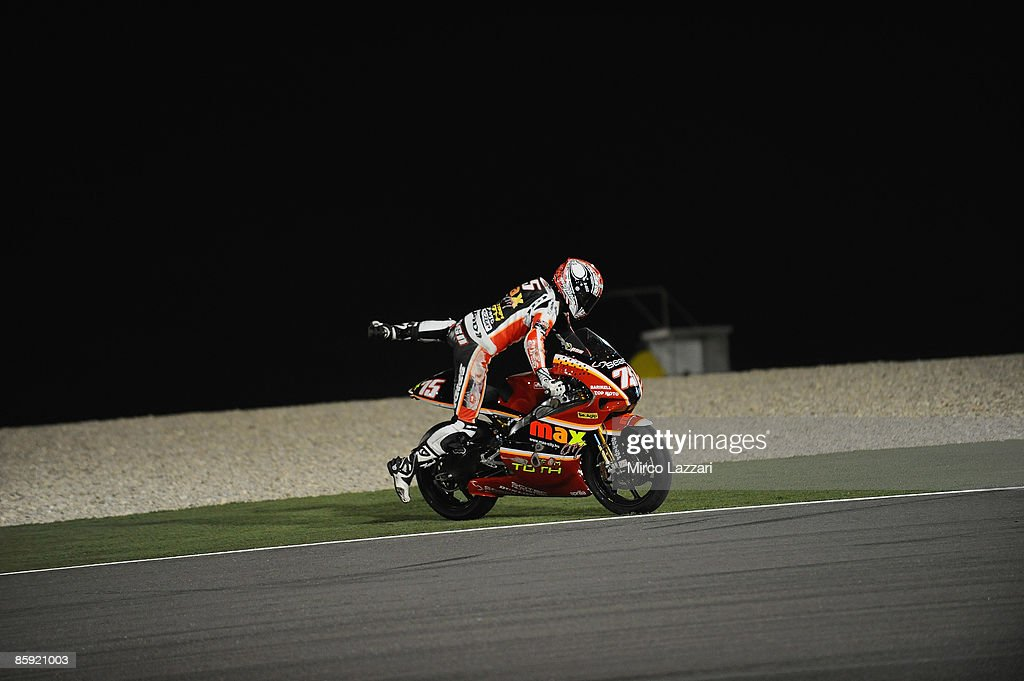 Mattia Pasini of Italy and Team Toth Aprilia restart after crash during the race to the Motorcycle Grand Prix of Doha on April 11, 2009 in Doha, Qatar.