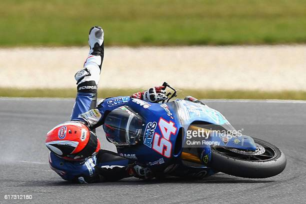Mattia Pasini of Italy and the Italtrans Racing Team crashes in the Moto2 race during the 2016 MotoGP of Australia at Phillip Island Grand Prix...