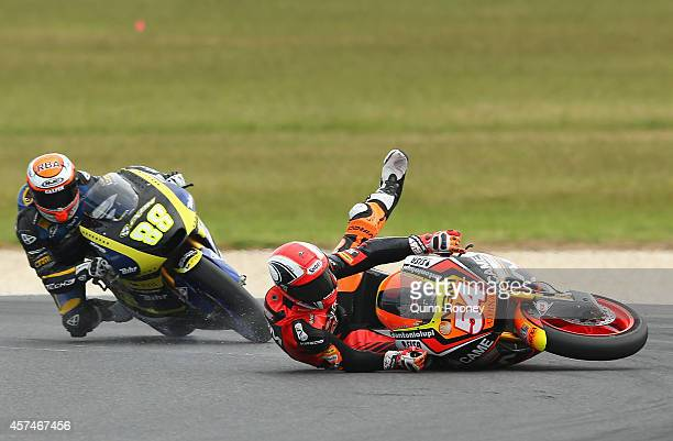 Mattia Pasini of Italy and the NGMForward Racing Kalex crashes during the Moto2 race at the 2014 MotoGP of Australia at Phillip Island Grand Prix...
