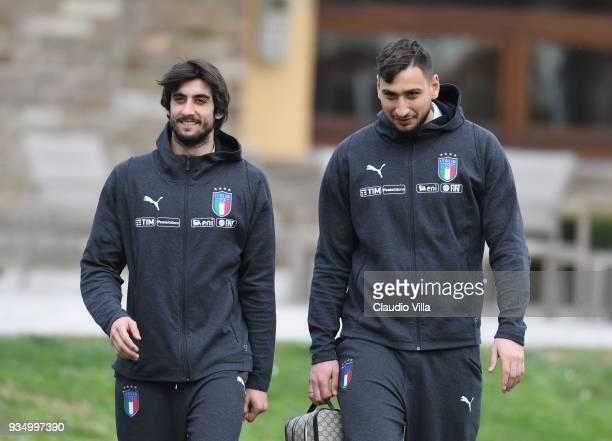 Mattia Perin and Gianluigi Donnarumma of Italy chat prior to the Italy training session at Centro Tecnico Federale di Coverciano on March 20 2018 in...