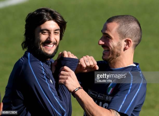 Mattia Perin and Leonardo Bonucci of Italy react during a Italy training session at Sisport Mirafiori on October 8 2017 in Turin Italy