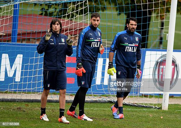 Mattia Perin Gianluigi Donnarumma and Gianluigi Buffon look on during the training session at the club's training ground at Coverciano on November 10...